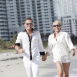 Young couple walking on the beach — Stock Photo #2597989
