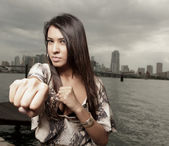 Woman throwing a punch — Stock Photo