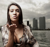 Woman blowing a kiss — Stock Photo