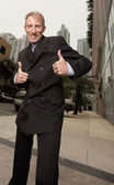 Businessman showing two thumbs up — Stock Photo