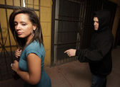 Man trying to snatch the woman's purse — Stock Photo