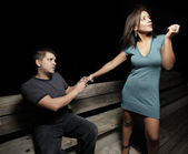 Man begging the woman not to leave — Stock Photo