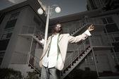 Man posing by a light pole — Stock Photo