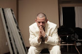 Groom praying before the wedding — Stock Photo
