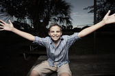 Boy with arms outstretched — Stock Photo