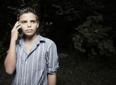 Young boy talking on a cellular phone — Stock Photo