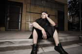 Bored man sitting on the curb — Stock Photo