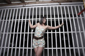 Woman posing by the building gate — Stock Photo
