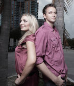 Young couple back to back — Stock Photo