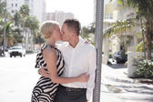 Young couple kissing on teh street — Stock Photo