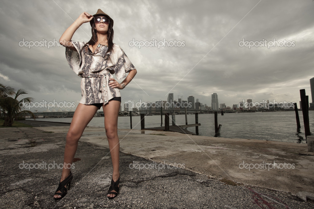 Image of a fashionable young woman posing by the bay — Photo #2590878
