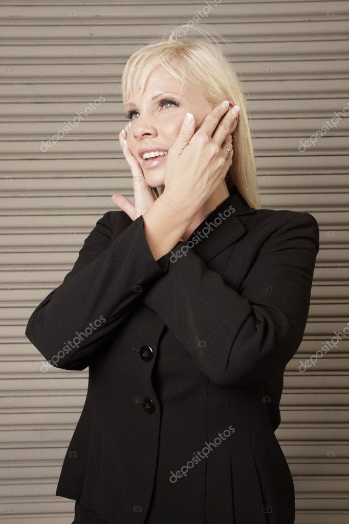 Attractive young woman with her hands by her face — Stock Photo #2592386