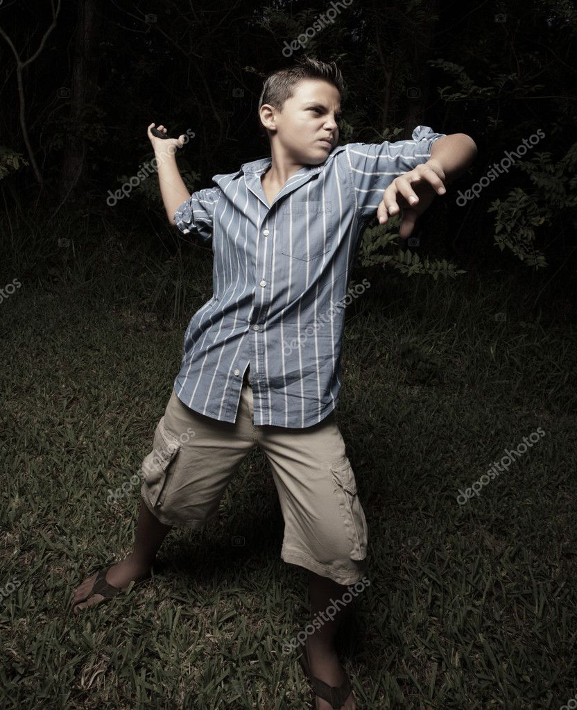 Young boy throwing a rock in the dark — Stock Photo #2592627