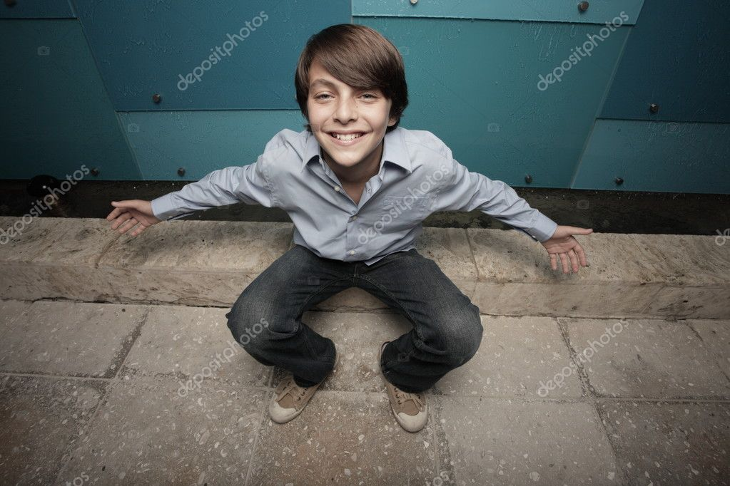 Young boy looking up towards the camera with a positive attitude  Stock Photo #2593917