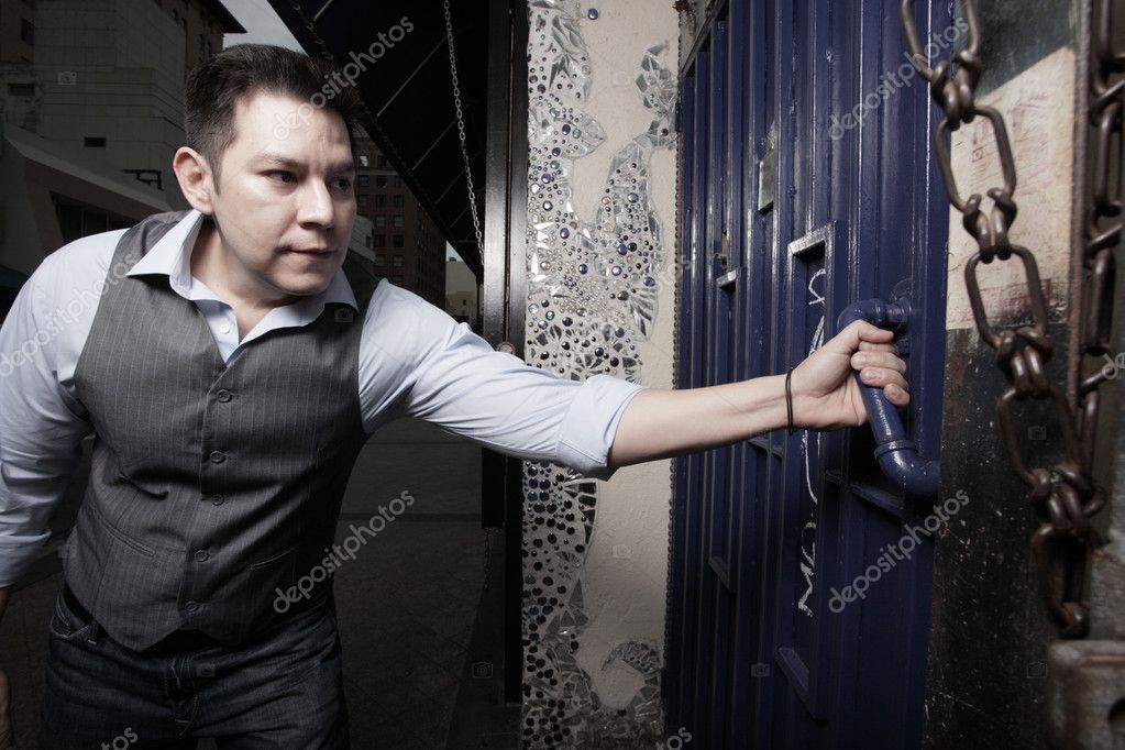 Young man trying to open the door — Stock Photo #2595094
