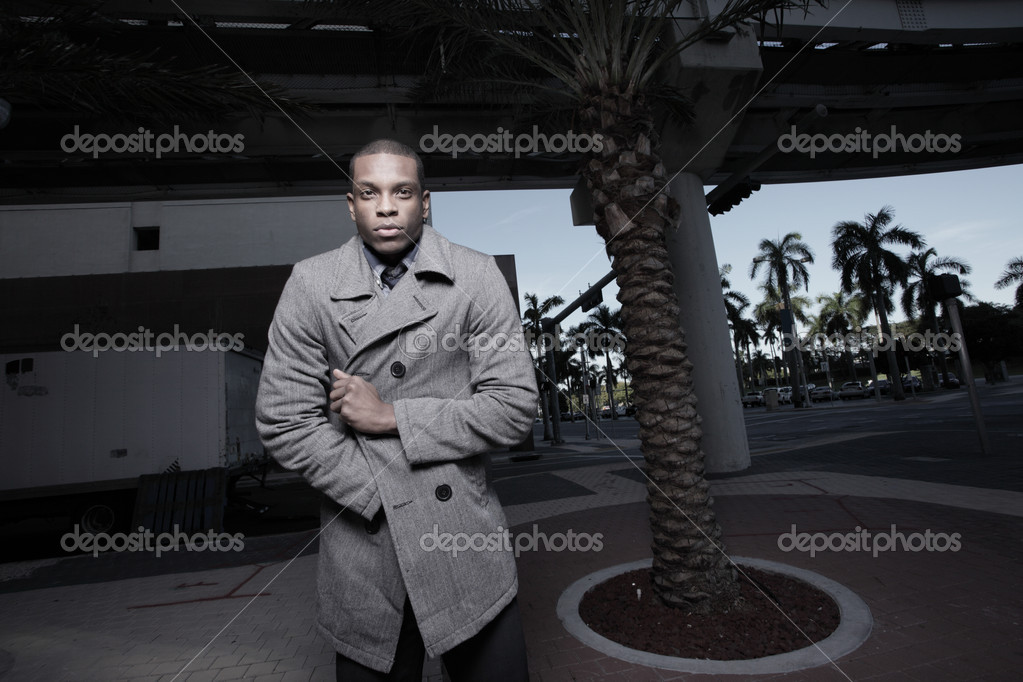Young man in an urban setting wearing a wool coat to keep warm — Photo #2597066