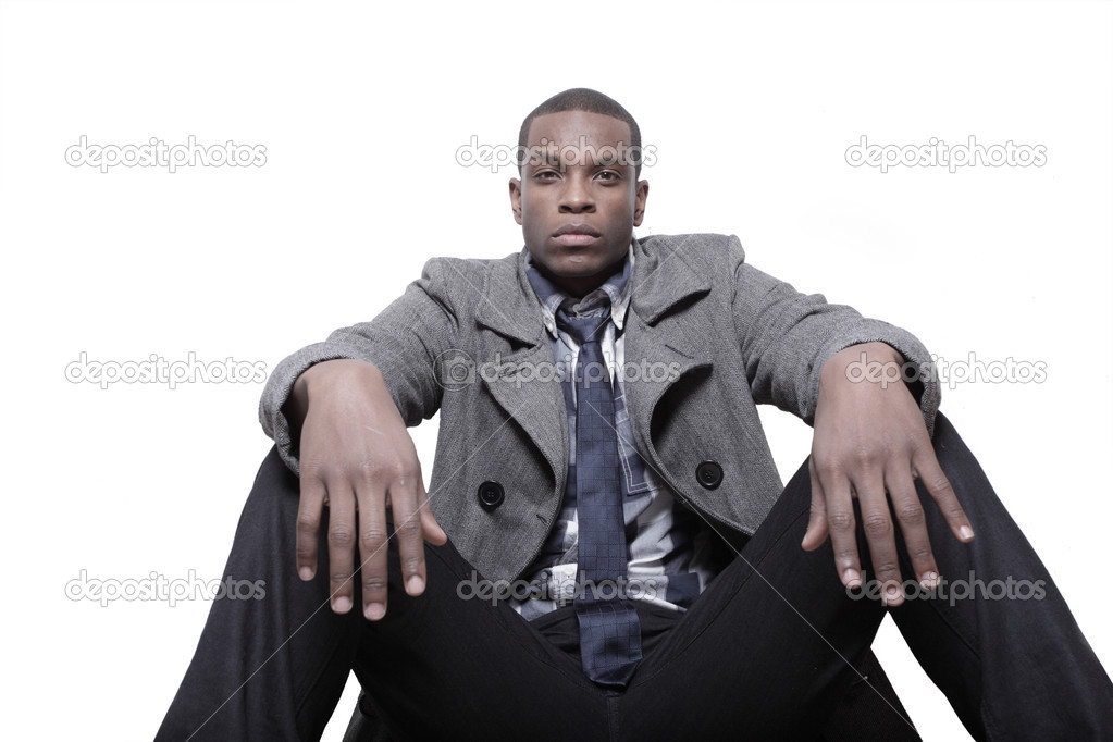 Young African American man sitting with an attitude  Stock Photo #2597115