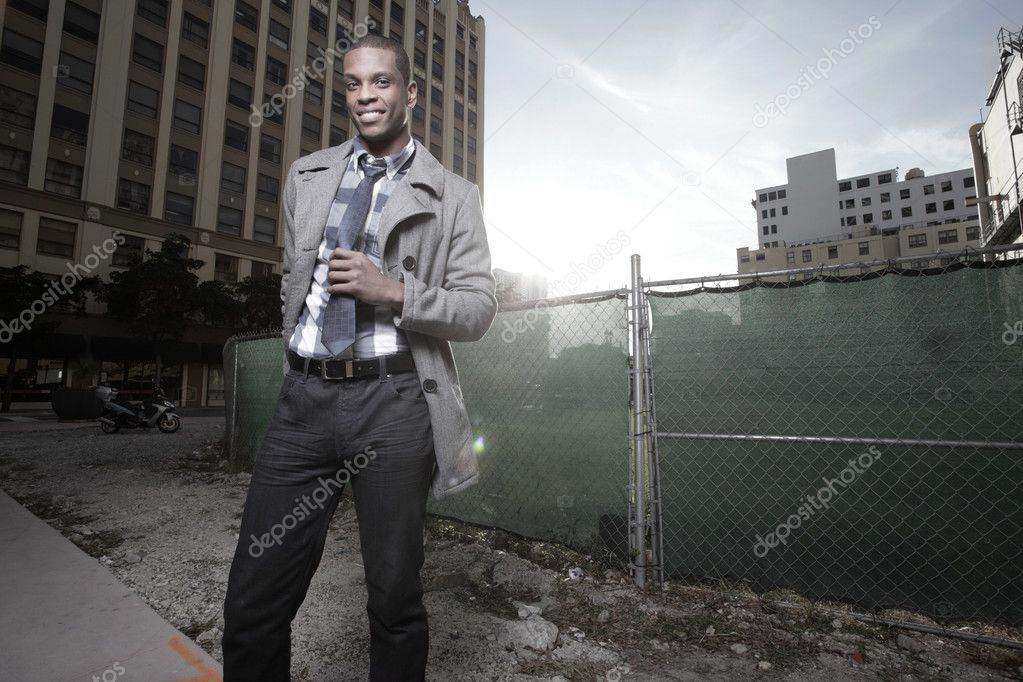 Attractive African American man smiling in an urban setting — Stock Photo #2597117