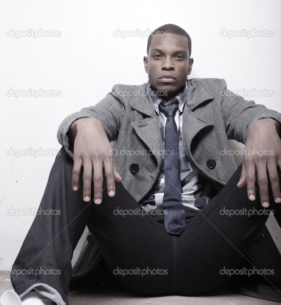 Young African American man sitting with an attitude — Stock Photo #2597135
