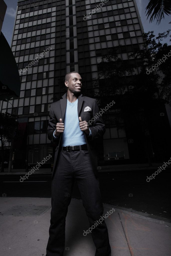 Handsome man in the city during dusk — Stock Photo #2597173