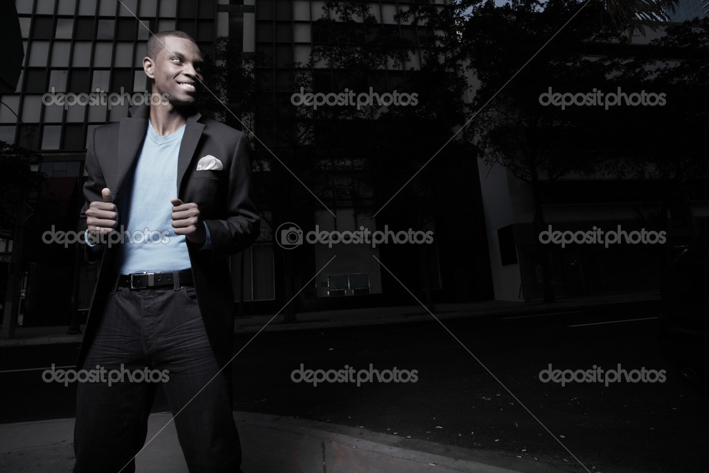 Handsome man in the city during dusk — Stock Photo #2597183