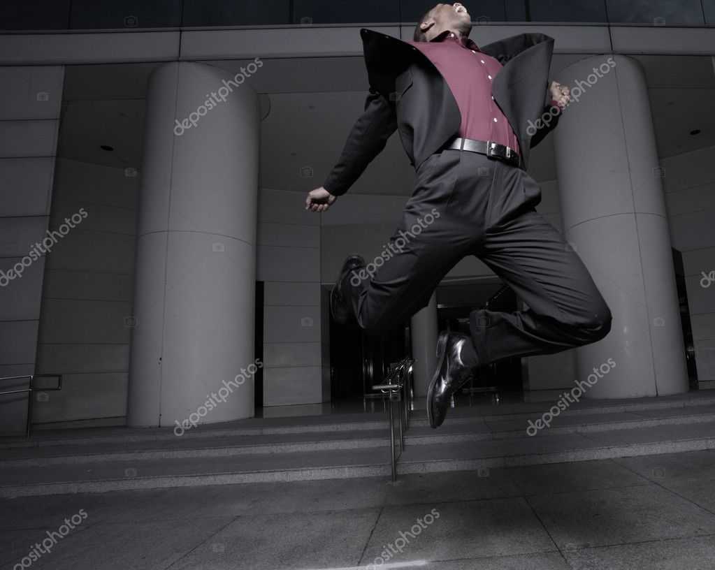 Young businessman jumping for joy after receiving a raise at work   #2597301