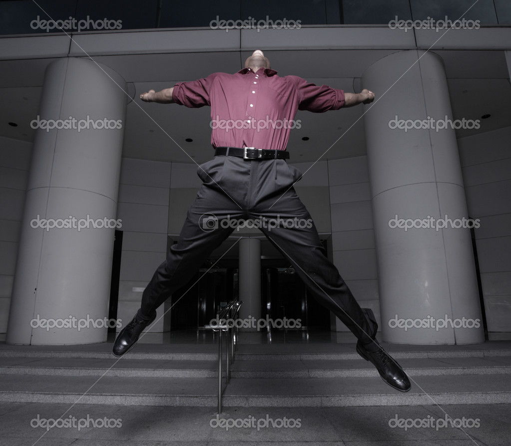 Young businessman jumping for joy after receiving a raise at work — Stock Photo #2597326