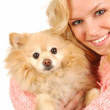 Girl and Pomerian — Stock Photo