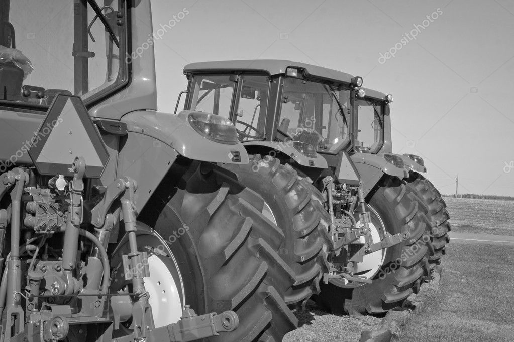 A row of modern farm tractors each with a slow moving vechicle sign. — Stock Photo #2336945
