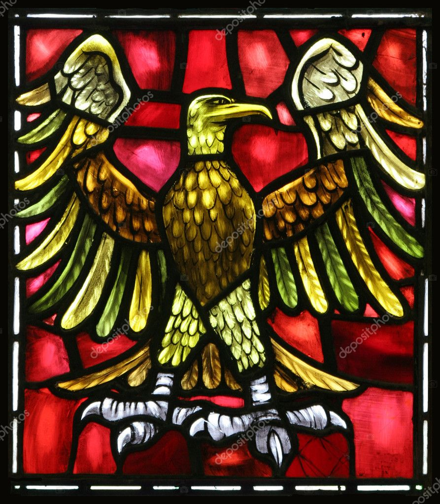 The eagle is the evangelical symbol of St. John.  From an old stained glass window in an Anglican Church in Bermuda. — Stock Photo #2370897