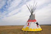 A lone teepee set up on the Alberta prairie. — Stock Photo