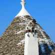 Traditional house roof in Puglia, Italy - Stock Photo