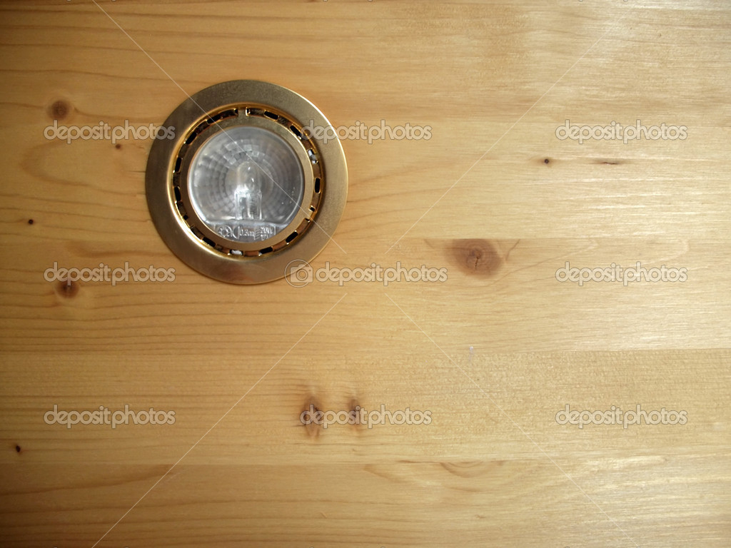 Golden spot light in pine wood panel — Stock Photo #2352936