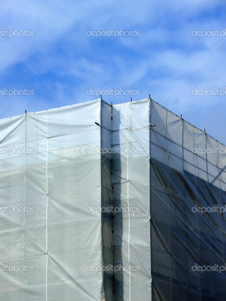 Covered scaffolding around a highrise building — Stock Photo #2415538