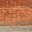 Brick wall and sidewalk — Stockfoto