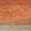 Brick wall and sidewalk - Stock Photo