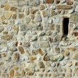 Stone wall background and window — Stock Photo