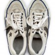 Old white worn sneakers seen from above - Stock Photo
