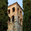 Bell tower between cypresses — Stock Photo