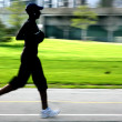 Jogging panning blur silhouette — Stock Photo