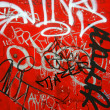 Graffiti on red, vertical — Stok fotoğraf