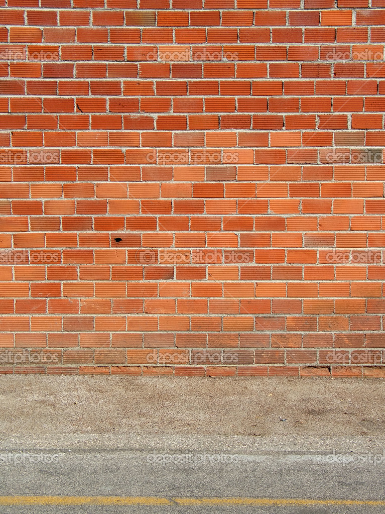 Red brick wall and sidewalk, vertical — Stock Photo #2463413