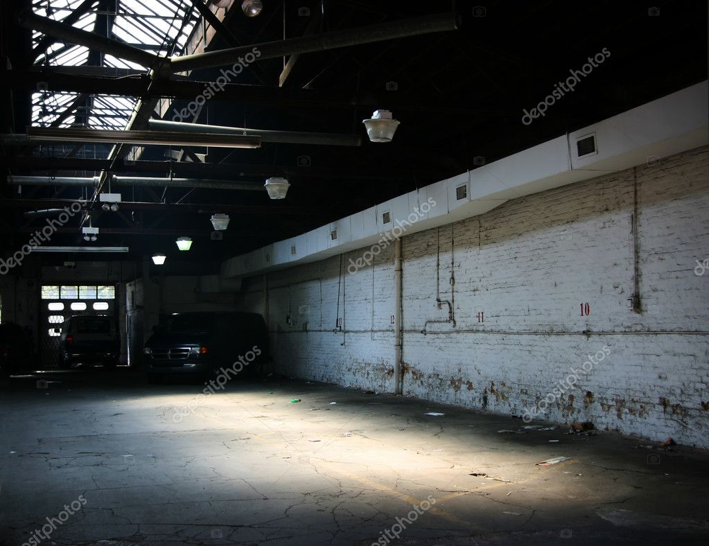 Almost empty industrial warehouse parking, a bit grungy — Stock Photo #2468081