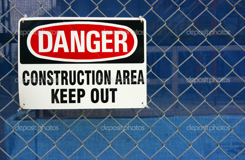 Danger construction area sign on site fence — Stock Photo #2468678