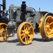 Older yellow grey tractor, front side — Stock Photo