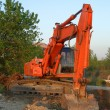 Orange excavator vertical - Stock Photo