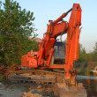 Stock Photo: Orange excavator vertical