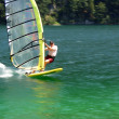 Stock Photo: Speeding windsurfer panning blur
