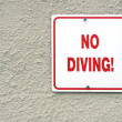 Stock Photo: Red no diving sign