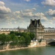 Louvre Museum seen from Orsay - Stock Photo